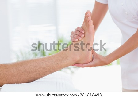 Man having foot massage in medical office
