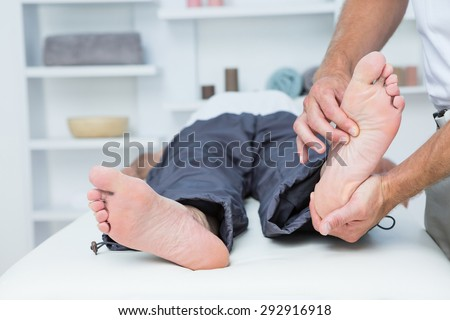 Man having foot massage in medical office - stock photo