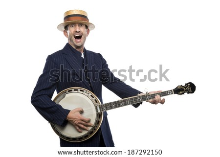Man having fun with a banjo, retro vintage outfit, great expression - stock photo