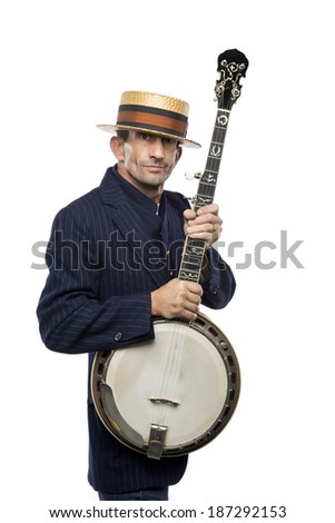 Man having fun with a banjo, retro vintage outfit, great expression