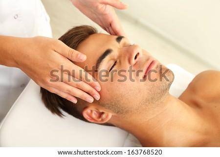 Man having head massage close up - stock photo