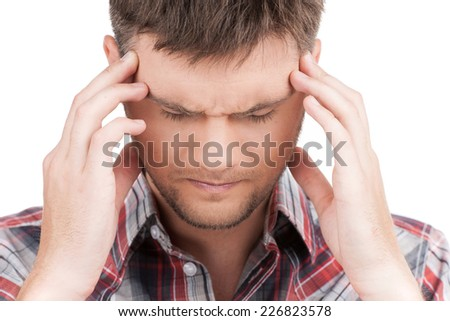 man having headache on white background. front view of guy feeling stress and depression holding head - stock photo