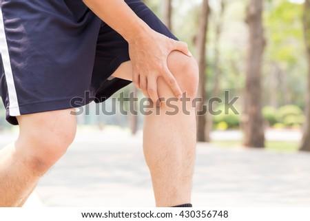 Man having knee pain while exercising, Sport injury concept - stock photo