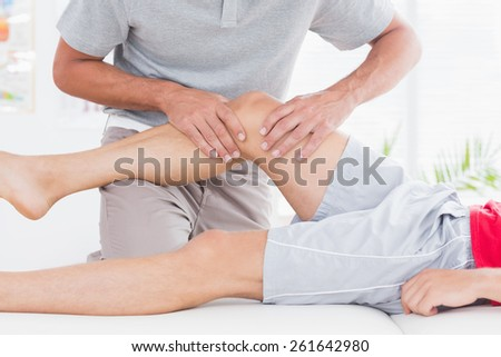 Man having leg massage in medical office