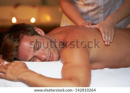 Man Having Massage In Spa - stock photo