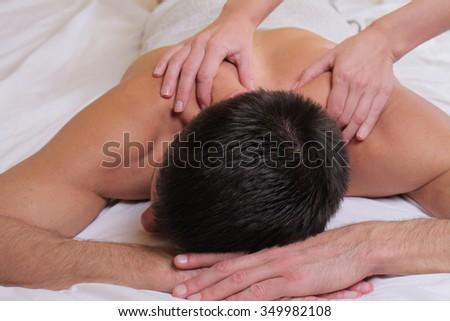 Man having massage. Relaxation, body care treatment, spa, wellness concept - stock photo