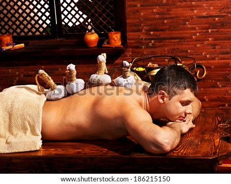Man  having oil Ayurveda spa treatment. - stock photo