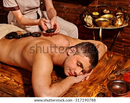 Man  having oil Ayurveda spa treatment. - stock photo