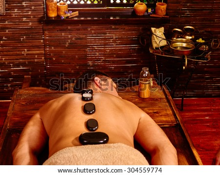 Man  having oil Ayurveda treatment. Spa resorts in India - stock photo