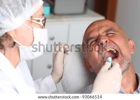 Man having pain at the dentist - stock photo
