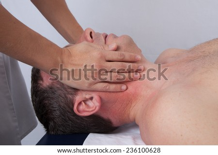 man having pain in his jawbone - stock photo