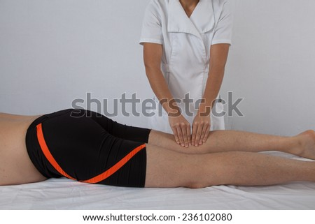 man having pain in his leg - sports injury - stock photo
