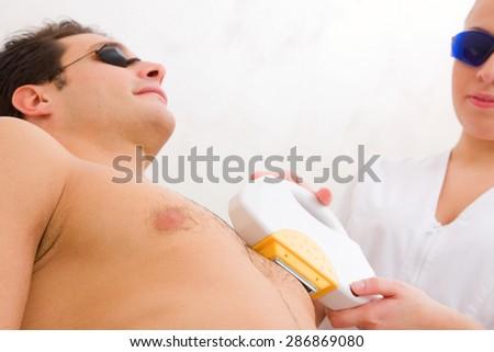 man having pulsed light hair removed - stock photo