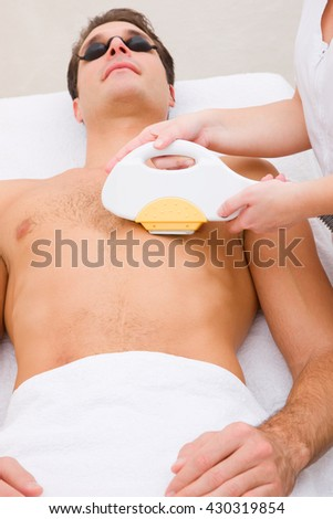man having pulsed light hair removed - stock photo