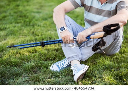 Man having rest after work-out on the grass