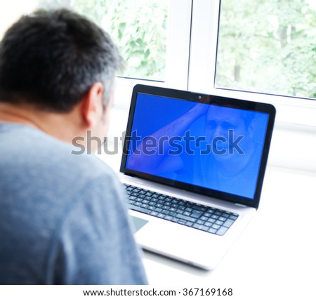 Man having trouble with laptop - stock photo