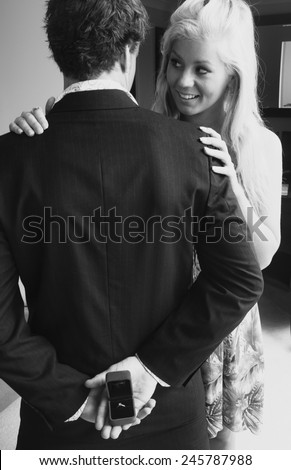 Man hiding a engagement ring ready to propse - stock photo