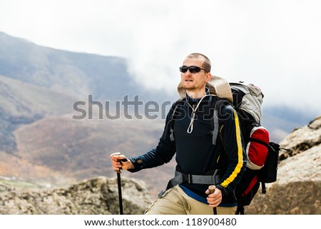 Man hiker hiking portrait in high Himalaya Mountains in Nepal. Trekking in summer nature
