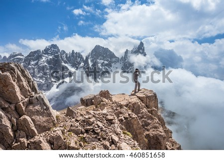Man hiker on a top of a mountain