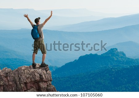 man hiking in mountains - stock photo