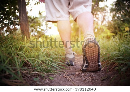 Man hiking in the countryside  - stock photo