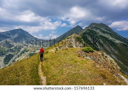 Man hiking on a path in the mountain wilderness