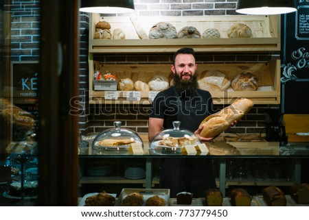 man hipster works in the bakery