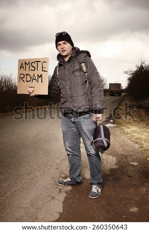 Man hitch-hiking to Amsterdam