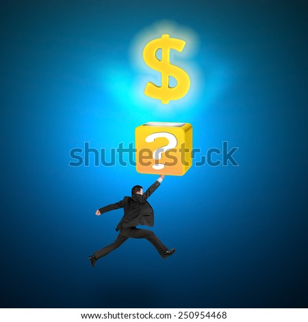 Man hitting question mark box opening glowing golden dollar sign isolated on blue - stock photo