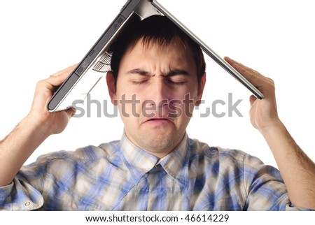 Man hold a laptop like a roof of house. Isolated on white. Frustrated programmer earned for his own home. - stock photo