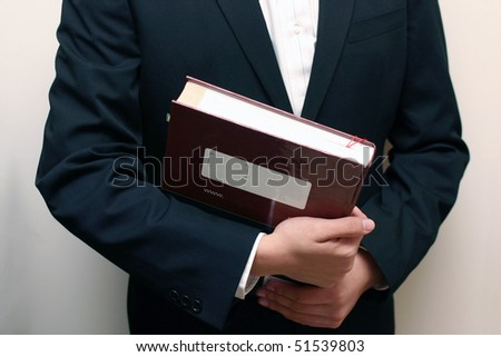 Man hold a textbook as a student. - stock photo