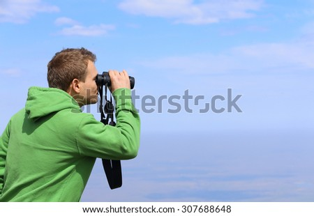 man hold binocular outdoor