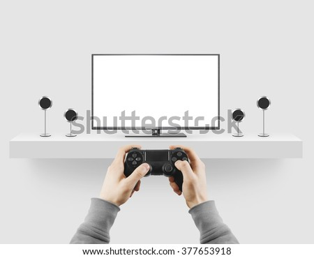 Man hold gamepad in hands in front of blank tv screen mock up playing game. Clear monitor mockup with gamer first person. Video gaiming console screen display. Gamer play game pad on tv screen. - stock photo