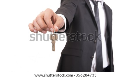 man hold home key