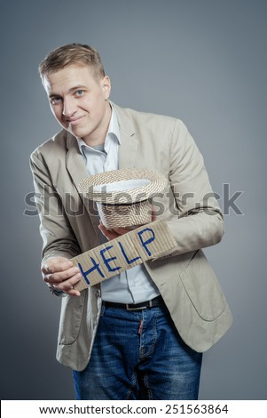 man hold in hand hat to donate and a card help - stock photo