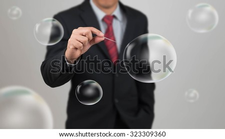 man hold needle stab an empty bubble - stock photo