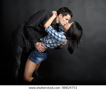 Man hold woman in hands