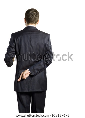 man holdind cross finger behind his back - stock photo