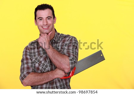 Man holding a backsaw - stock photo