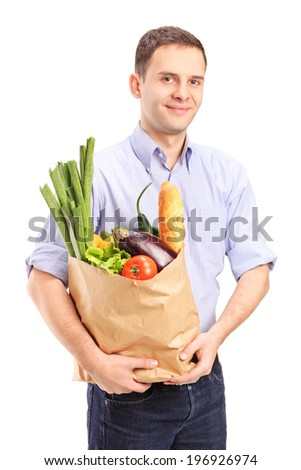 Man holding a bag full of groceries isolated on white background