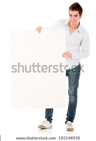 Man holding a banner and smiling - isolated over a white background - stock photo