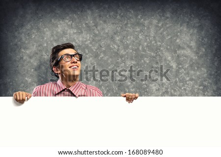man holding a banner in front of him and surprised - stock photo