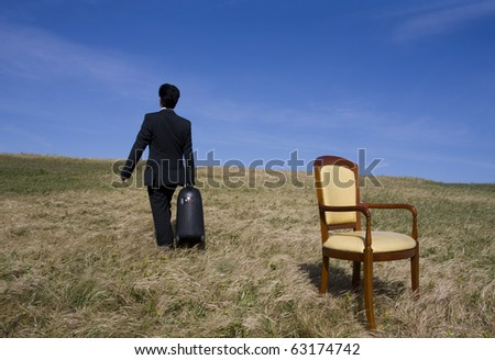 Man holding a big travelling bag going away alone - stock photo