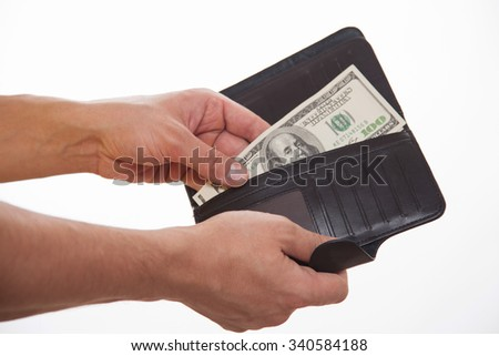 Man holding a black purse and money, white background
