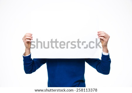 Man holding a blank paper over white background - stock photo