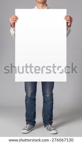 Man holding a blank poster - stock photo