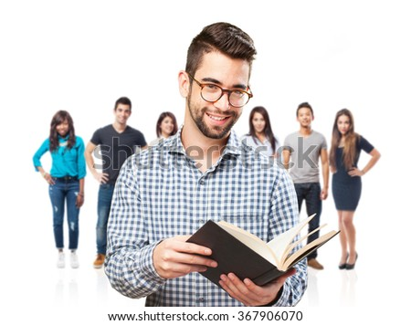 man holding a book - stock photo