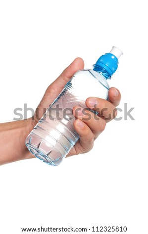 Man holding a bottle of water isolated on white background - stock photo