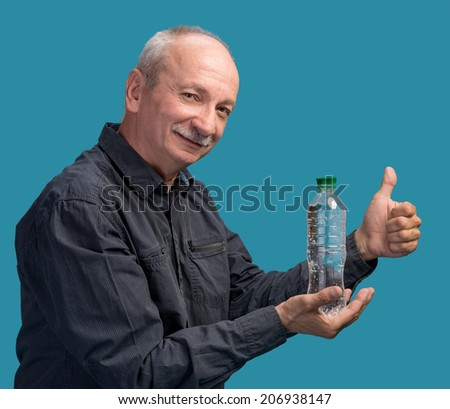 Man holding a bottle of water on a blue background