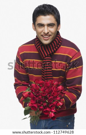 Man holding a bouquet of flowers - stock photo